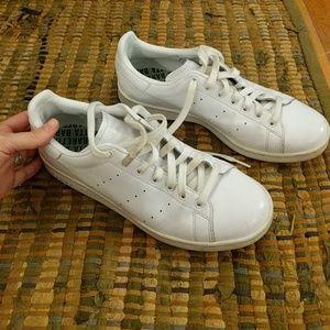 All white Adidas Stan Smith sneakers